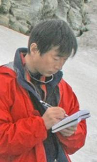 Yushin Ahn writing research notes in the Arctic.