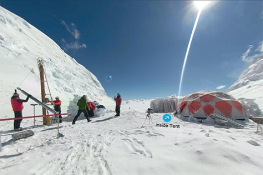 A view team members working an ice core drill at Huascaran