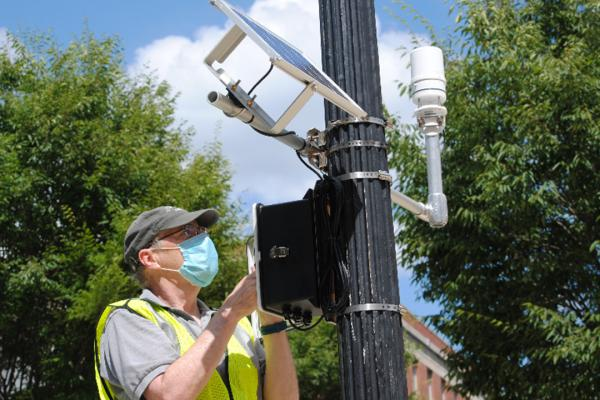 Jim DeGrand installs sensors around the OSU campus.