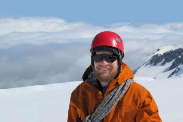 Richard Alley, standing on a snow covered mountain.