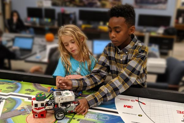 Lego league teammates work on solving their latest challenge.